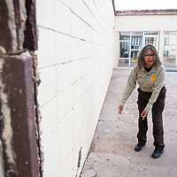 Ophelia Begay, corrections lieutenant at the Window Rock Detention Center points out the slope in the ground causing cracks in the wall at the detention center Wednesday, March 6, in Window Rock, Arizona.