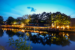 Freischwimmer cafe and bar beside canal in Kreuzberg , Berlin at night.Germany