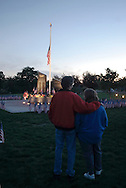 Washingtonville, N.Y. - A couple stand in front of the Washingtonville 5 Firefighters World Trade Center Memorial before a candlelight service on Sept. 11, 2006. The Memorial was built in honor of five FDNY firefighters from Washingtonville and the many others who lost their lives on September 11, 2001 in the World Trade Center terrorist attack.<br />