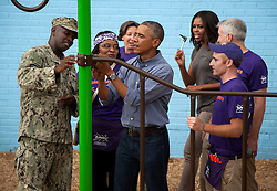 President Barack Obama and Michelle Obama take part in a service project at the Inspired Teaching School to commemorate the September 11th National Day of Service and Rememberence, in Washington, DC, USA on September 11, 2014. The president and first lady assisted volunteers in building an outdoor playground. Photo by  Martin H. Simon/Pool/ABACAPRESS.COM  | 465814_017 Washington Emirats Arabes Unis United Arab Emirates