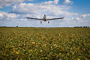 2015/03/05 – Monte Maiz, Argentina: A plane fumigates a soy field close by the town of Monte Maiz. Residents claim that the aerial pulverizations are one of the many causes for the cases of cancer grow exponentially in the area since the introduction of glyphosate on the soya cultivation. 26,000,000 Liters of pesticides are sprayed in Argentina - which per hectare is ten times more than in the USA.  (Eduardo Leal)