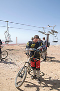 Israel, Golan Heights, Mount Hermon in Summer. The skilift is used to transport downhill bicycle rider to the peak
