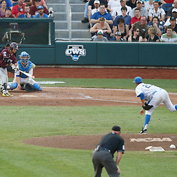 Jun 25, 2013; Omaha, NE, USA; Mississippi State Bulldogs second baseman Brett Pirtle (left) reaches on a fielding error in front of UCLA Bruins catcher Shane Zeile (right) during the fourth inning in game 2 of the College World Series finals at TD Ameritrade Park. Mandatory Credit: Derick E. Hingle-USA TODAY Sports