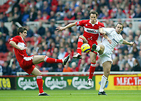 7/11/2004 - FA Barclayship Premiership - Middlesbrough v Bolton Wanderers - The Riverside Stadium<br />Middlesbrough's Gareth Southgate (centre) and Chris Riggott try to get the ball ahead of Bolton Wanderers' Kevin Davies<br />Photo:Jed Leicester/Back Page Images