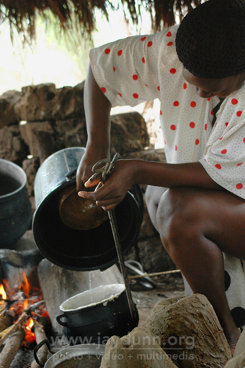 Ghana, Adaklu, Titikope, 2007. A woman makes banku, or mashed cassava, which is a staple and takes many hours to prepare.