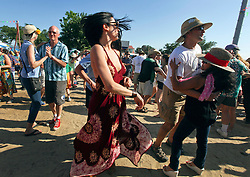 03 May 2015. New Orleans, Louisiana.<br /> The New Orleans Jazz and Heritage Festival. <br /> Dancing at the Fais Do-Do stage. <br /> Photo; Charlie Varley/varleypix.com