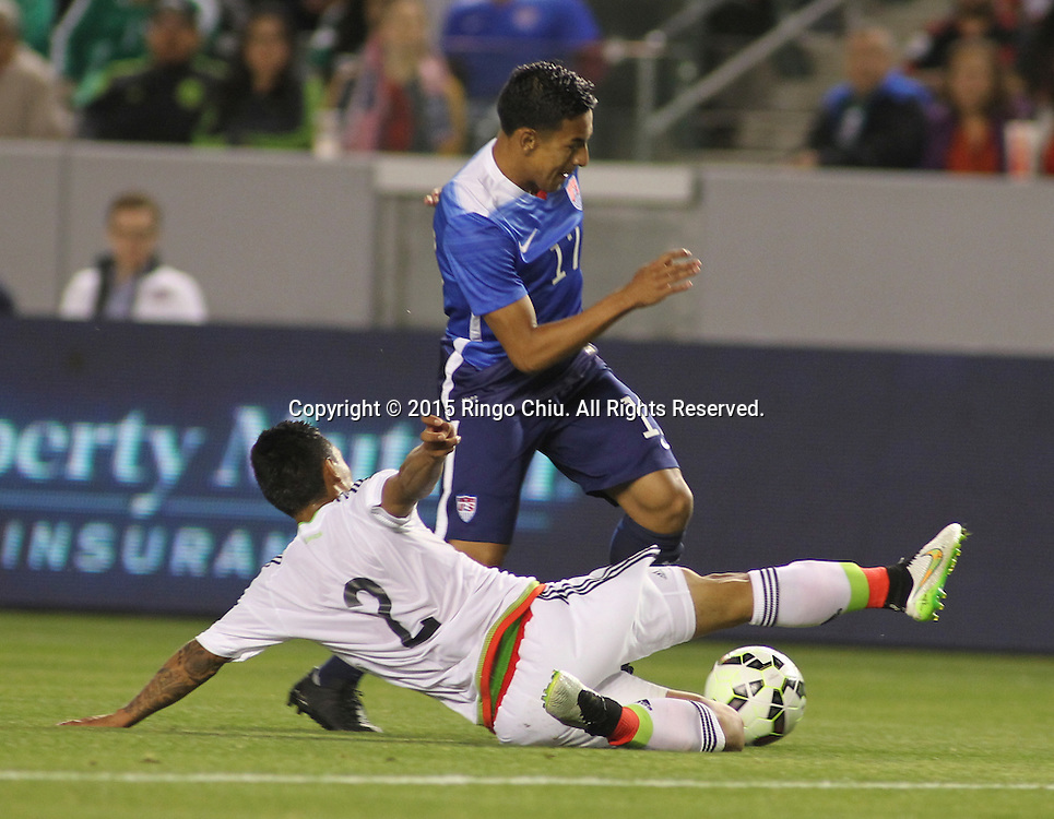 United States' Jose Villarreal #17 and Mexico's Gil Bur—n #2 fight for a ball during a men's national team international friendly match, April 22, 2015, at StubHub Center in Carson, California. United States won 3-0. (Photo by Ringo Chiu/PHOTOFORMULA.com)