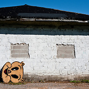 A smiling pig face sign is all that remains of an abandoned store in Minnesota.