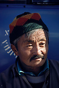 Portrait of a truck driver in Ulaanbaatar, Mongolia. Material World Project.