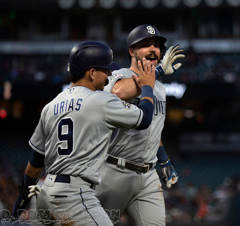 San Diego Padres' Austin Hedges, right, celebrates his two-run home run with teammate Luis Urias (9) during the fourth inning of a baseball game against the San Francisco Giants, Thursday, Aug. 29, 2019, in San Francisco. (AP Photo/D. Ross Cameron)