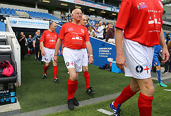 England's Tommy Charlton (middle) arrives on to the pitch on his England debut before the Walking Football International match at The AMEX Stadium, Brighton.