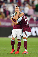 Football - 2021 / 2022 Premier League - West Ham United vs Leicester City - London Stadium - Monday 23rd August 2021<br /> <br /> West Ham United's Mark Noble with Said Benrahma at the final whistle.<br /> <br /> COLORSPORT/Ashley Western