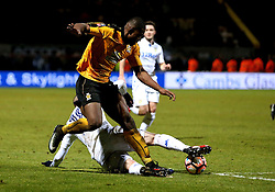 Uche Ikpeazu of Cambridge United is tackled by Pontus Jansson of Leeds United - Mandatory by-line: Robbie Stephenson/JMP - 09/01/2017 - FOOTBALL - Cambs Glass Stadium - Cambridge, England - Cambridge United v Leeds United - FA Cup third round