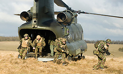 4 Mech Bde taking part in the Mission Specific Training on Salisbury Plain Training Area before deployment to Helmand Province Aghanistan. Once the simulated Casualty has been loaded onto the RAF Chinook more troops exit to stabilise the situation on the ground  9 Feb 2010