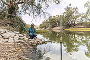 Menindee Fish Kill Story.  Pic shows Badger Bates, Aboriginal Elder on the Darling River at Menindee
