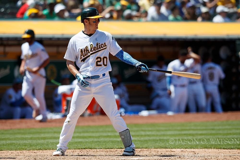 OAKLAND, CA - JUNE 17: Mark Canha #20 of the Oakland Athletics at bat against the Los Angeles Angels of Anaheim during the seventh inning at the Oakland Coliseum on June 17, 2018 in Oakland, California. The Oakland Athletics defeated the Los Angeles Angels of Anaheim 6-5 in 11 innings. (Photo by Jason O. Watson/Getty Images) *** Local Caption *** Mark Canha