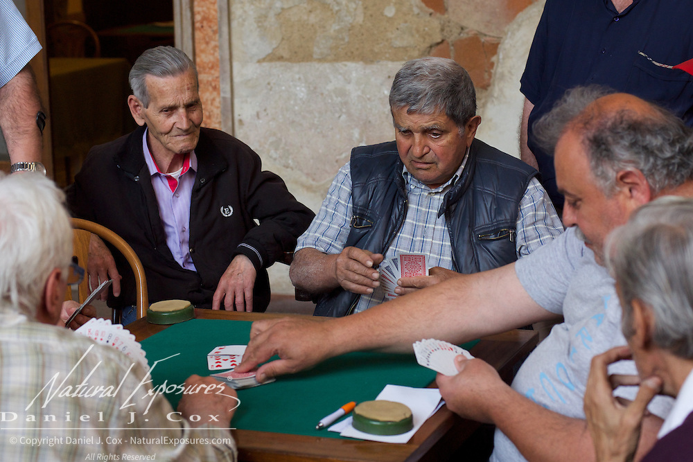 Men playing cards at the Workers Mutual Aid Society in Sorrento, Italy