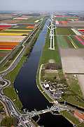 Nederland, Noord-Holland, Gemeente Zijpe, 28-04-2010; Burgervlotbrug, vlotbrug in het Noordhollandsch Kanaal. Bloembollenvelden in de achtergrond. .Floating bridge, bulbfields..luchtfoto (toeslag), aerial photo (additional fee required).foto/photo Siebe Swart