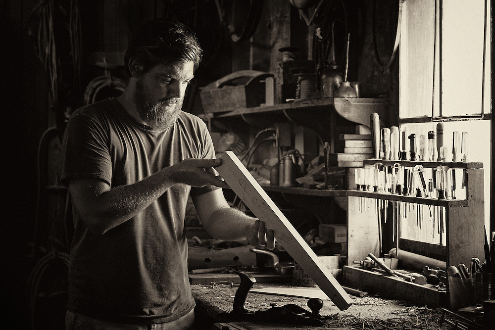 Ckeching a custon wood piece for a new boat at the St Michaels Boat house in St Michaels Marylandw