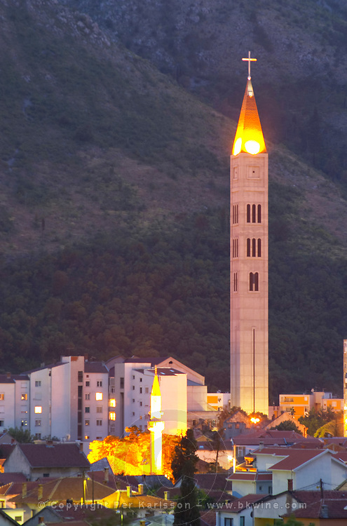 View over the city at sunset. Mosque minarets. Franciscan Monastery and church. Historic town of Mostar. Federation Bosne i Hercegovine. Bosnia Herzegovina, Europe.