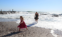 """South Africa - Cape Town - 17 June 2020 -Azora Kayli-Quani (7) and Olivia Burton having fun Along the Sea Point Promenade soaking up the sunlight, and enjoying the warm day following a few rainy days Picture"""" Brendan Magaar/African News Agency(ANA)"""