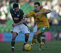 Photo: Lee Earle.<br /> Plymouth Argyle v Norwich City. Coca Cola Championship.<br /> 14/01/2006. Plymouth's David Norris (L) battles with Darren Huckerby.