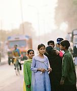 Portrait of family in a local street, Lucknow, Uttar Pradesh, India