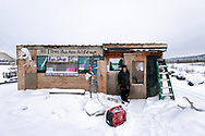 Elizabeth and her son Charley run a small business at the Yukon Camp where the Yukon River meets the Dalton Highway. She stands here in front of their shop.