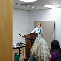 Charlotte J. Frisbie, at the podium, discusses her book with guests at the Octavia Fellin Public Library  in Gallup.