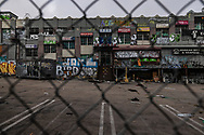 808 S.Western Ave. IB Plaza shops have been closed for the duration of the pandemic. The building was scheduled to undergo renovations and get turned in to a boutique hotel and apartment mixed use structure. The plaza is now overtaken by the homeless and covered in graffiti.