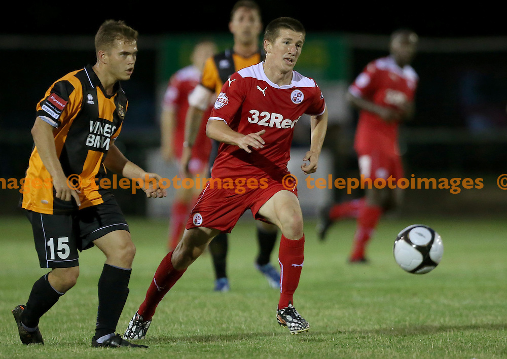 Crawley's Emmett O'Connor and Charlie Leach in action during the pre season friendly between Three Bridges and Crawley Town at Jubilee Field in Crawley. July 28, 2014.<br /> James Boardman TELEPHOTO IMAGES