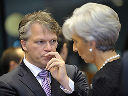 Wouter Bos, the Netherlands's finance minister, left, speaks with Christine Lagarde, France's finance minister, during ECOFIN, the meeting of EU finance ministers, at the European Council headquarters in Brussels, Belgium, on Tuesday, Nov. 10, 2009. (Photo © Jock Fistick)