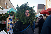 A stall holder at the market dressed up in Christmas style head gear as a silly gesture to indicate it's December and Christmas is coming. Columbia Road flower market is held every Sunday and it attracts shoppers from afar. The huge variety in plants and flowers makes it a popular place to shop and the banter between the traders and the quick deals there is to be made makes it a very entertaining place to go.