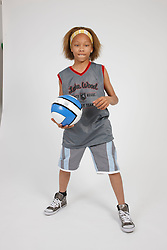 Portrait of boy in sports clothes with basketball