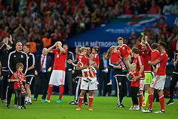 LILLE, FRANCE - Friday, July 1, 2016: Wales' Neil Taylor on the pitch with his children as he celebrates the 3-1 victory against Belgium at full time after the UEFA Euro 2016 Championship Quarter-Final match at the Stade Pierre Mauroy. (Pic by Paul Greenwood/Propaganda)