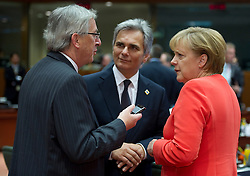 Jean-Claude Juncker, Luxembourg's prime minister, left, speaks with Angela Merkel, Germany's chancellor, right, and Werner Faymann, Austria's chancellor, center, during the European Summit meeting at EU Council headquarters in Brussels, Belgium, on Thursday, June 17, 2010. (Photo © Jock Fistick)