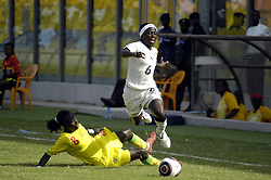 Black Queen's captain, Florence Okoe (R), is tackled by Senegalese player, Absa Sylla, in a qualifying match at the Ohene Djan Sports Stadium in Accra on June 6, 2010.Ghana beat the Senegalese team 3-0 to claim one of the seven places available for the African Women's Championship (AWC) to be hosted by South Africa in September, 2010. (Credit: Emmanuel Quaye/Twenty Ten/Africa Media Online)