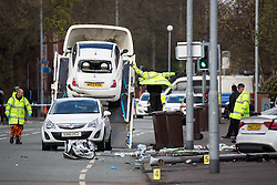 © Licensed to London News Pictures . 27/04/2016 . Manchester , UK . Cars are lifted on to a vehicle carrier at the scene . Scene where police report two died in a fatal RTA involving a white Audi A5 at 03:15 this morning (Weds 27th April) . Greater Manchester Police report they observed the vehicle shortly before it crashed in to street furniture on Wilbraham Road in Chorlton, close to Whalley Range High School For Girls . Photo credit : Joel Goodman/LNP
