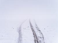 Aerial view of a frozen road in the Blizzard in Rohukula, Estonia.