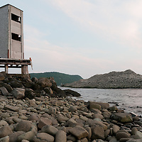 An old lookout at Dark Harbour on the west coast of Grand Manan Island, New Brunswick. The western shore of Grand Manan is mostly inaccessible except by boat. Dark Harbour is one of the few exceptions. Abandoned buildings dot the shore of Dark Harbour, from a once booming cod fishery. Photo by William Drumm.