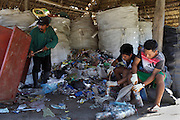 In the village of Dinomarko community volunteers collect discarded rubbish and stuff plastic bottles to be used as eco-bricks. There is a growing problem in Amazonian communities with the build-up of plastic and unrecyclable rubbish. Alianza Arkana runs several waste management programs in communities to help them look after and recycle their waste.