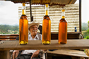 Roadside vendor selling honey in the mountains of Costa Rica.