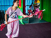 26 AUGUST 2018 - GEORGE TOWN, PENANG, MALAYSIA: Performers rehearse a fight scene before a Hokkien style Chinese opera on the Lim Jetty in George Town for the Hungry Ghost Festival. The opera troupe came to George Town from Fujian province in China. The Hungry Ghost Festival is a traditional Buddhist and Taoist festival held in Chinese communities throughout Asia. The Ghost Festival, also called Ghost Day, is on the 15th night of the seventh month (25 August in 2018). During the Hungry Ghost Festival, the deceased are believed to visit the living. In many Chinese communities, there are Chinese operas and puppet shows and elaborate banquets are staged to appease the ghosts.      PHOTO BY JACK KURTZ