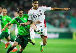 Etien Velikonja of NK Olimpija vs Jamarro Bernardus Diks of AS Trencin during 1st Leg football match between NK Olimpija Ljubljana (SLO) and FK AS Trenčin (SVK) in Second Qualifying Round of UEFA Champions League 2016/17, on July 13, 2016 in SRC Stozice, Ljubljana, Slovenia. Photo by Vid Ponikvar / Sportida