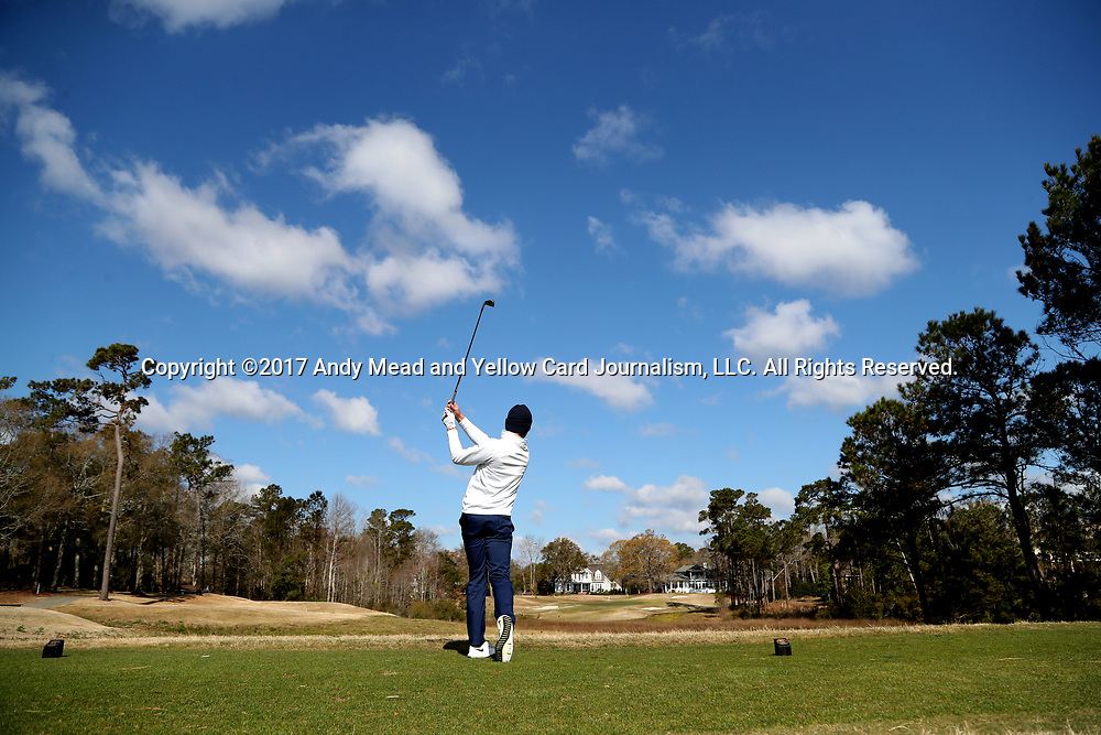 WILMINGTON, NC - MARCH 19: North Carolina's Austin Hitt tees off on the Ocean Course sixth hole. The first round of the 2017 Seahawk Intercollegiate Men's Golf Tournament was held on March 19, 2017, at the Country Club of Landover Nicklaus Course in Wilmington, NC.