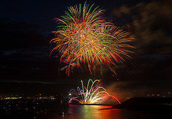 © Licensed to London News Pictures. 15/08/2019; Plymouth, Devon, UK. Day two of the British Fireworks Championships, with the first display by the Illusion team. The British Fireworks Championships is one of the biggest firework displays in the country, held in Plymouth Sound each August when firework companies from across the UK compete for the best display. The British Fireworks Championships began in 1997 and Plymouth Sound harbour was chosen for the location as it provides a natural amphitheatre for large scale pyrotechnics that can be used safely away from the public but watched from many viewpoints around the Sound'. Photo credit: Simon Chapman/LNP.