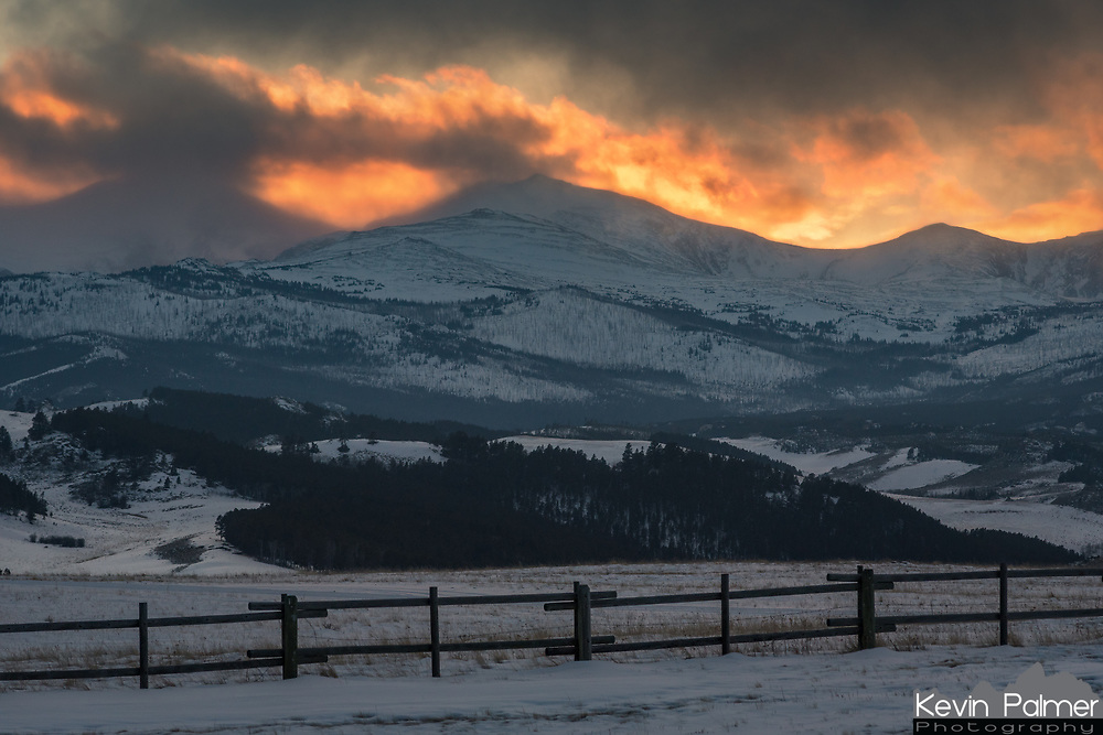 While coming down from the Bighorn Mountains I was treated to a dramatic sunset ahead of an incoming snowstorm. The mostly hidden peak on the left is Darton Peak, with Peak Angeline in the middle. Both of them are over 12,000 feet high. I often wonder what it would be like to watch a sunset like this from the summit of a tall peak in the winter. One thing for sure is that it would be brutally cold. This picture almost didn't happen because I was in a rush to return my rental skis before the shop closed at 6:00. After taking this one last shot I made it there with 2 minutes to spare.