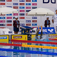 Competitor falling into the pool before the start of a swimming competition during the Swimming European Championships.