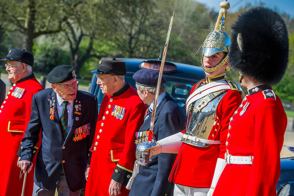 Charles Jeffries, 93 D-day/Dessert Rat, John Cuthbert, 92, Peter Kent, 90 Royal Navy, Tpr Joel Robinson, 20, L Cpl Stephen Hubball, 25 (L to R) - Second World War Veterans, Reg Wilderspin (89) and John Cuthbert (92), and serving Guardsmen on Horse Guards Parade Ground to highlight Royal British Legion events on Victory in Europe (VE) Day. The Legion is also announcing that veterans and their carers will receive funding towards attending the event on the weekend of the 8-10th May.<br /> <br /> Places will be available for a series of commemorative events over the weekend including on VE Day itself, Friday 8 May, when a Service of Remembrance will be held at The Cenotaph, with a national two minute silence at 3pm. On Sunday 10 May, there will a Service of Thanksgiving at 11am at Westminster Abbey attended by HM The Queen, followed by a parade from the Abbey to Horse Guards Parade and into St James's Park, where the Legion will host a lunch reception for the veterans.