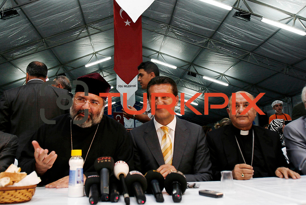 Sisli Mayor Mustafa SARIGUL kisses Catholic Assyrian leader Yusuf SAG on his head as the Turkey's Armenian Patriarch Mesrob II, left, smiles as they chat during an iftar, the evening meal that breaks the daily fast, on the first day of Ramadan in Istanbul, Turkey, Thursday, Sept. 13, 2007. Local Christian leaders joined Muslim worshipper in an iftar meal on the first day of the Islamic fasting month of Ramadan.<br /> Photo by Str./TURKPIX